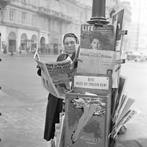 Zeitungsverkäuferin