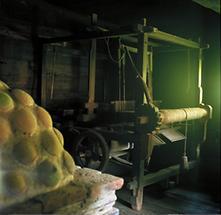 Webstuhl in einsamen Bauernhaus