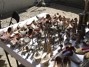 Shoes, sculptures, and goblets