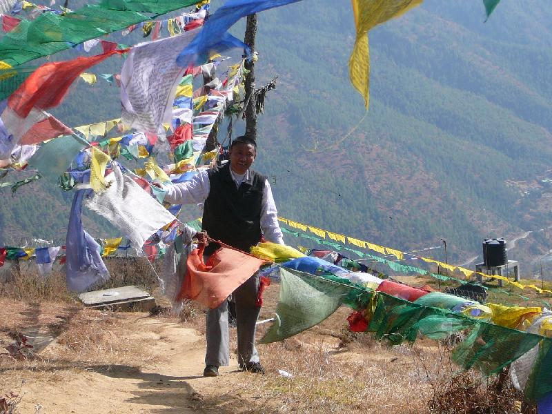 Chen Chen Dorji with prayer flags