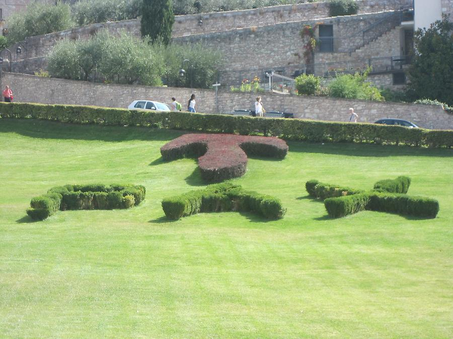 Assisi - PAX symbol on lawn in front of Franciscan Monastery