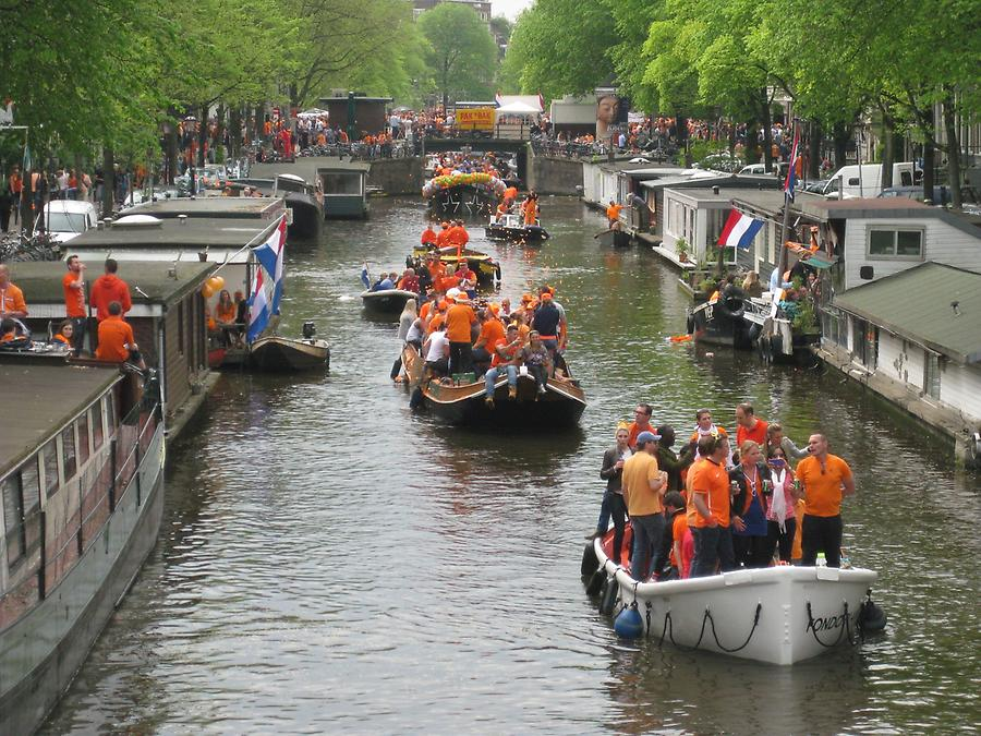 Amsterdam - Koningtag - Boat Parade with people dressed in orange