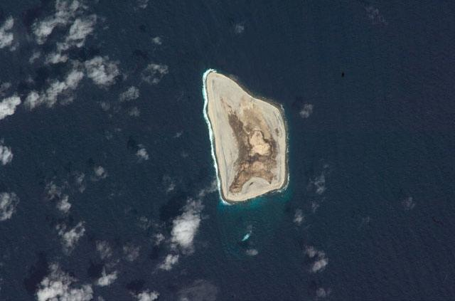Satellite photo of Johnston Atoll, about 1,390 km (860 mi) west of Hawaii. Four islands compose the total land mass of 2.6 sq km. Johnston and Sand islands are both enlarged natural features, while Akau and Hikina are two artificial islands formed by coral dredging. Johnston Island, by far the largest, somewhat resembles the flattop of an aircraft carrier and contains an airstrip. Photo courtesy of NASA.