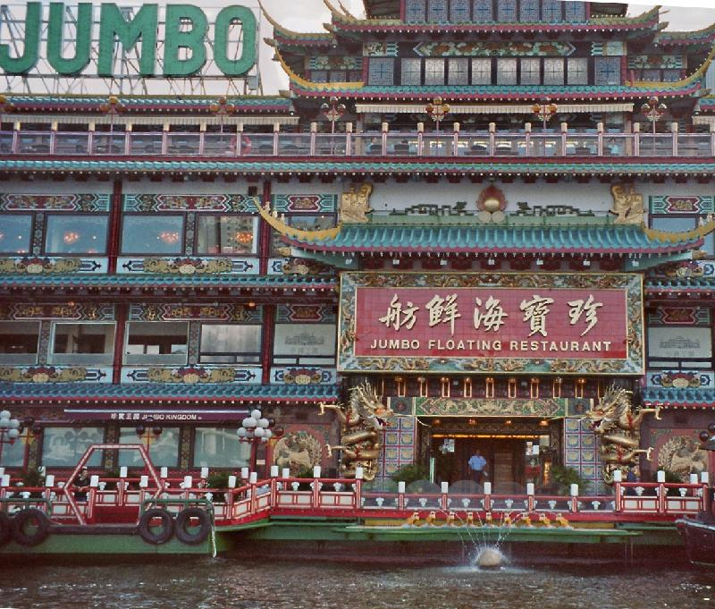 decor of the floating restaurant in green and red