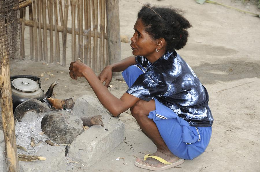 Aeta woman while cooking