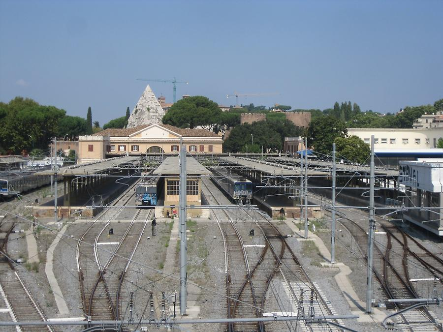 Railway station with pyramid in the background