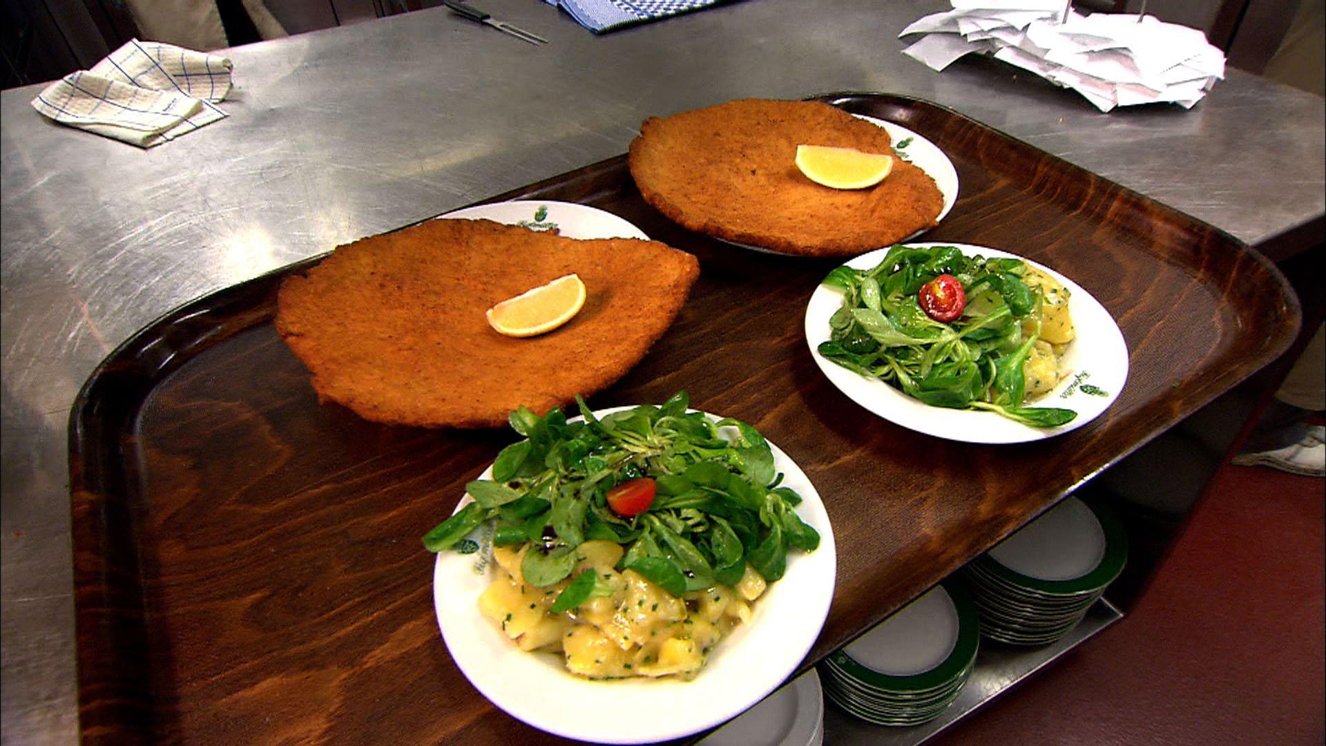Figlmueller wien signature wienner schnitzel dish with for Austrian cuisine vienna