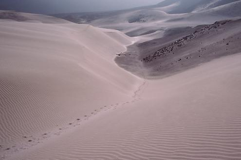 Hike through the sand desert. Here, the sand covers the processional way.