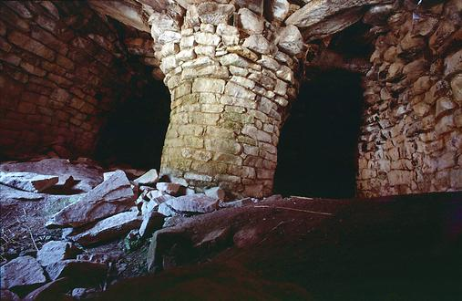The interior of a still intact stone house.
