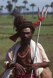 On pilgrimage in southern India. As an attribute he carries the trident of Shiva