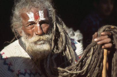 Vaishnava-Sadhus, the vertical signs on his forehead represent the footprint of God Vishnu