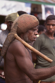 Dani man with stone axe